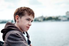 Portrait of teenager on background of river Royalty Free Stock Photography