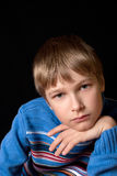 Portrait of a teenager on a black background Royalty Free Stock Images