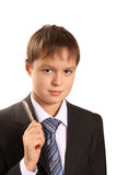 Portrait of  teenager boy holding pen Stock Image