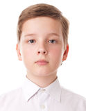 Teenager boy. The portrait of a teenager boy, isolated on a white background royalty free stock image