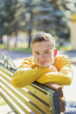 Portrait of a teenager boy in the park Royalty Free Stock Photo