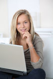 Portrait of teenager with computer Stock Images