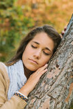 Portrait of a Teenager Embracing a Tree Royalty Free Stock Image