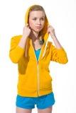 Portrait of teenager girl adjusting draped hood Royalty Free Stock Images