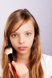 Portrait of teenager girl doing makeup Royalty Free Stock Photo
