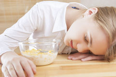 Portrait of Teenager Girl Sleeping on Table Surface Stock Photo