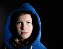 Portrait of a teenager in a hood Stock Images