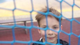 Teenager jumping over the net. Portrait of a teenager jumping over the net stock video footage