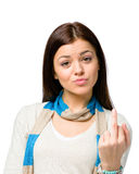 Portrait of teenager with obscene gesture Stock Photo