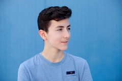 Portrait of a teenager rebellious man. With a blue background Stock Images