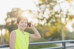 Portrait of a teenager smiling using his smartphone. On a basketball court Royalty Free Stock Photography