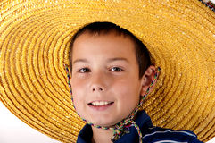 Portrait of the teenager  in a sombrero. The young eleven-year teenager  in a yellow sombrero Royalty Free Stock Image