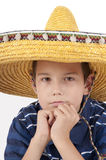 Portrait of the teenager in a sombrero. The eleven-year teenager in a sombrero props up a head hands stock photography