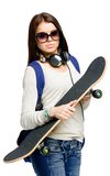 Portrait of teenager in sunglasses with skateboard Stock Photography