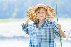 Portrait of teenager with twig fishing rod and Stock Photos