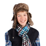 Portrait of teenager wearing fur hat. Isolation Royalty Free Stock Photo