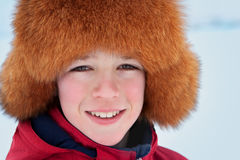 Portrait of teenager wearing fur hat Royalty Free Stock Image