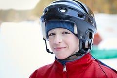 Portrait of teenager wearing helmet, winter. Portrait of teen wearing helmet, winter Stock Photos