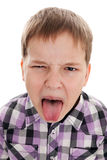 Portrait of the disobedient boy who is putting out the tongue Royalty Free Stock Images
