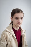 Portrait of teenager who is looking down Stock Images