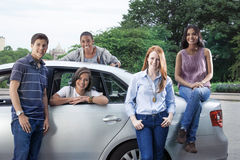 Portrait of teens with car Royalty Free Stock Photography