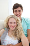 Portrait of teens couple sitting on the sofa Royalty Free Stock Photography
