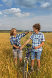 Portrait of a teens on rye field Royalty Free Stock Image