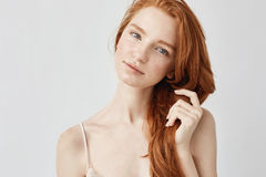 Portrait of tender beautiful girl with red hair smiling looking at camera. royalty free stock images