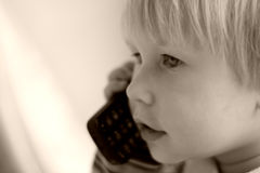 Portrait of the tender child. Speaking by phone Royalty Free Stock Photos
