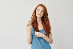Portrait of tender dreamy freckled ginger girl thinking, feeling insecure about her first date. Growing up into gorgeous royalty free stock photography