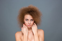 Portrait of tender natural woman with voluminous curly hairstyle Stock Photos