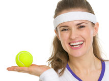 Portrait of tennis player showing tennis ball Royalty Free Stock Image