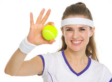 Portrait of tennis player showing tennis ball Royalty Free Stock Photos