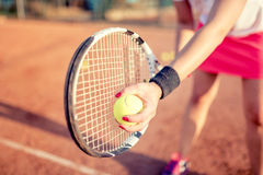 Portrait of tennis racquet with fitness girl. healthy training for sportswoman details. Close up portrait of tennis racquet with fitness girl. healthy training Royalty Free Stock Images