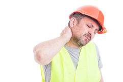 Portrait of tensed young constructor feeling exhausted royalty free stock photography