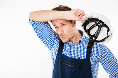 Portrait of tensed young constructor feeling exhausted after work Royalty Free Stock Images