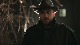 Portrait of terrible maniac at night in hat and stock video