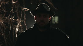 Portrait of terrible robber at night in hat and stock video