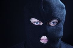 Portrait terrorist in masked. On a black background Stock Images