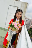 Portrait Thai Girl. In commencement day with flower ,  Thailand Stock Images