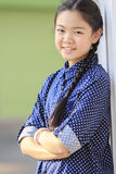Portrait of thai 12s years girl wearing blue shirt standing out Stock Photos