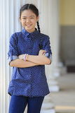 Portrait of thai 12s years girl wearing blue shirt standing out Stock Images