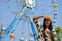 Portrait thai women with Ferris wheel. A Ferris wheel is a nonbuilding structure consisting of a rotating upright wheel with multiple passenger-carrying Royalty Free Stock Photography