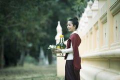 Portrait Thai women wear traditional Thai dresses. Portrait Thai woman wear traditional Thai dresses in temple stock photos