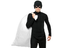 Portrait of a thief holding a bag. Isolated against white background Stock Images