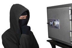 Portrait of thief thinking the lock code Stock Images