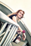 Portrait of thinking beautiful woman standing on the stairs Stock Image
