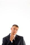 Portrait of thinking businessman looking upward Royalty Free Stock Images