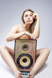 Portrait of Thinking Caucasian Blond Female with Loudspeaker Hol Stock Image