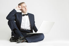 Portrait of Thinking Caucasian Man in Suit with Laptop. Stock Photography